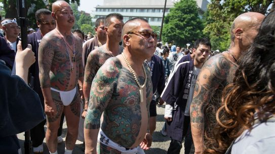 Members of the Takahashi-gumi gang are seen at a festival in the Asakusa district in Japan.