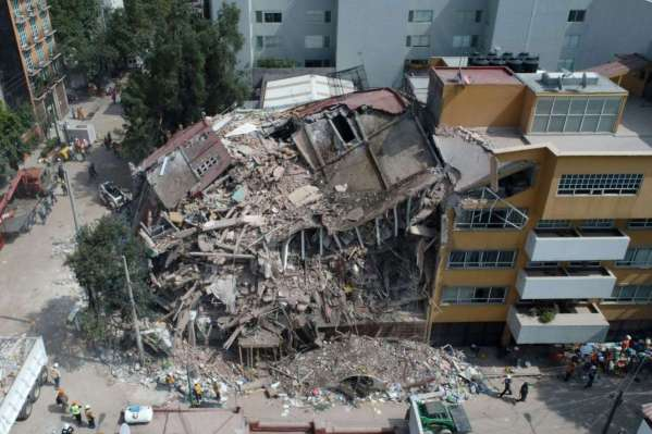 A photo of a ruined and flattened four-story building after the Puebla Earthquake that took place on September 20, 2017 in central Mexico.