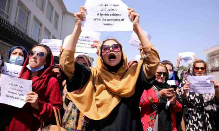 Afghan women holding signs protesting for women's rights in Afghanistan