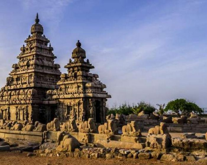 Intricate temple architecture is seen in the colour photograph, showing the art and ingenuity that went to building temples in Ancient India.The temple remains standing, with only rubble from the blocks of the pathway scattered.