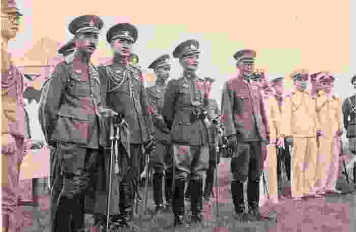 An opaque image of Siamese soldiers standing in line and in uniform in Siam.