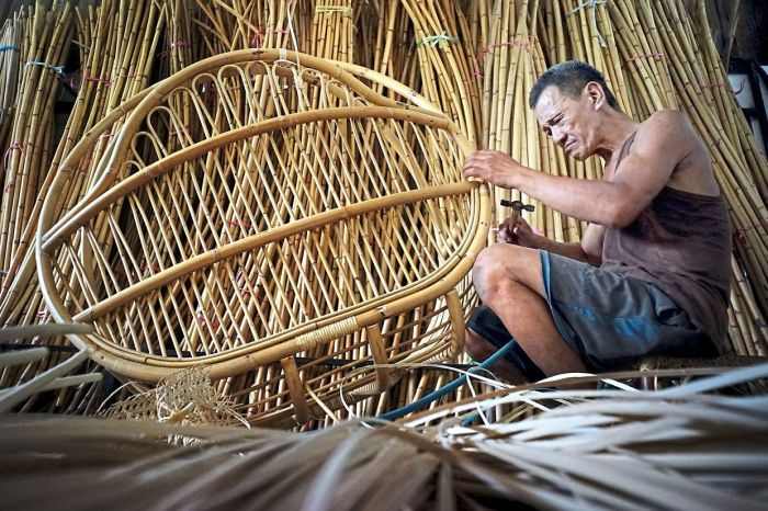 man weaving with rattan
