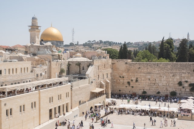 Aerial view of many people standing in front of the Western Wall