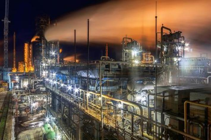 A photo of an industrial factory at night