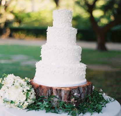 Wedding Cake Ideas  Simple and Clean Cake Designs   Inside Weddings White wedding cake on top of wood tree trunk slab