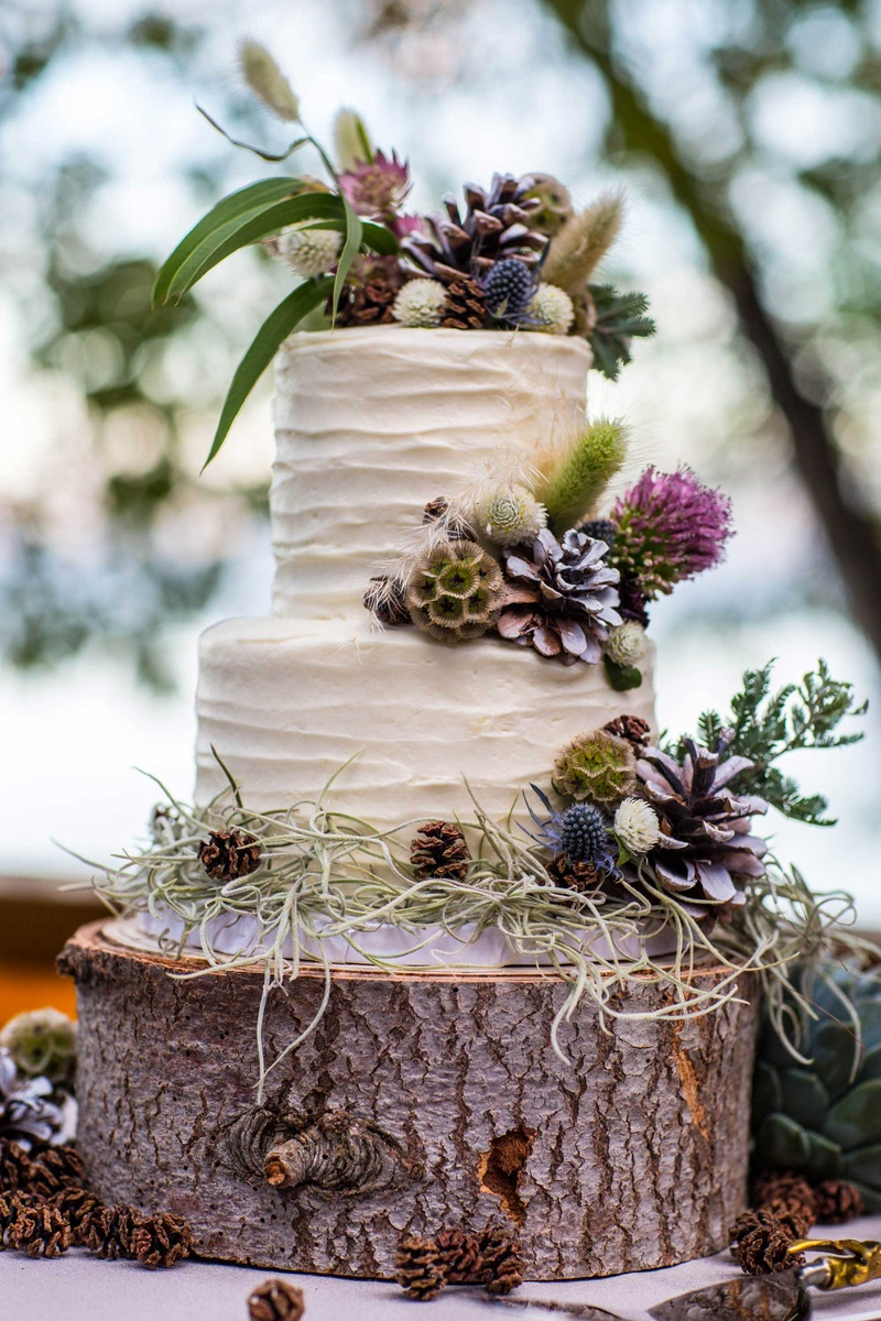 Cakes   Desserts Photos   Carrot Cake with Wildflowers   Inside Weddings carrot cake with cream cheese frosting on a tree trunk slab  decorated with  wildflowers