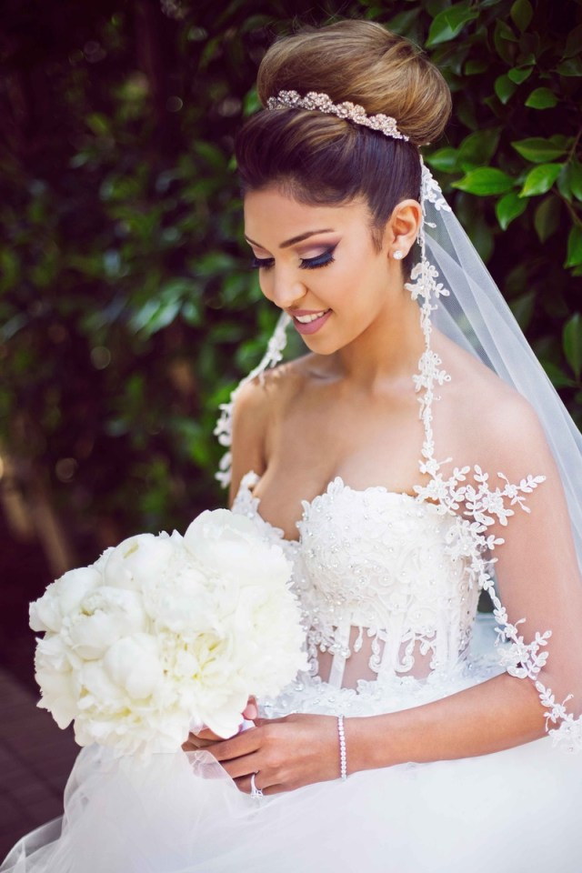 beauty photos - bride in updo smiles with bouquet - inside