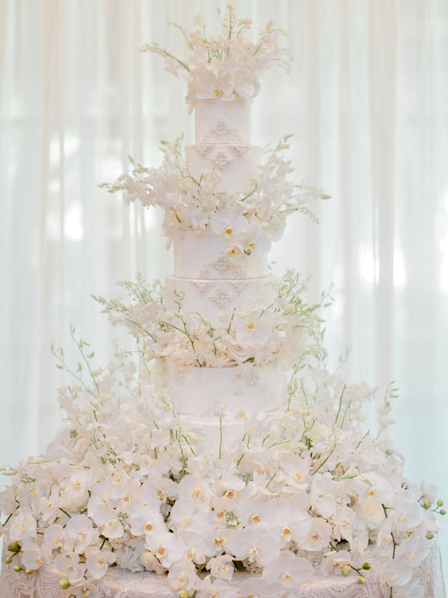 Wedding Ideas  Cake Ideas for Every Style   Inside Weddings Opulent white wedding cake ideas with hundreds of sugar flowers