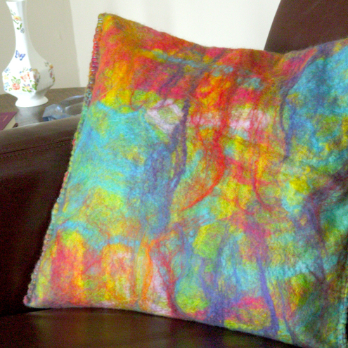 Felted wool cushion in rainbow colours