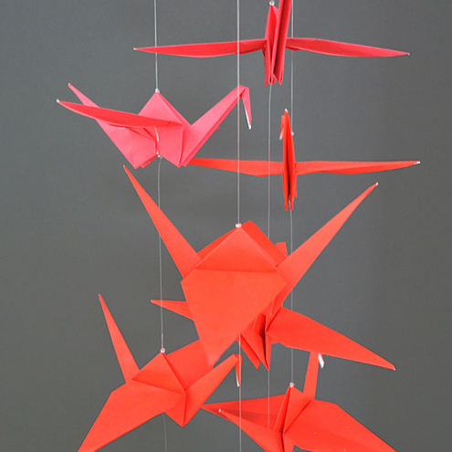 Coloured origami crane sculpture