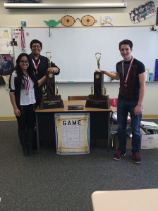 Schaumburg High School state debate students pose with their state trophies and medals. (Left) Sophomores Jessica D'Souza and Raza Haque (and right) junior Nathaniel Leonhardt.