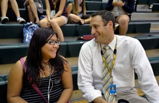 Kurt Tenopir, the new principal at Fremd High School, welcomes sophomore student Karla Carmona Navarrete on the first day of school.