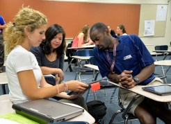 Hoffman Estates High School teachers Natalie Tindle (left) Jasmin Chung (center) and Tyrone Jones (right) collaborate during an Institute Day session on Aug. 19. During the teachers' first day back at school, they worked together to learn new technology tools they can use during the school year.