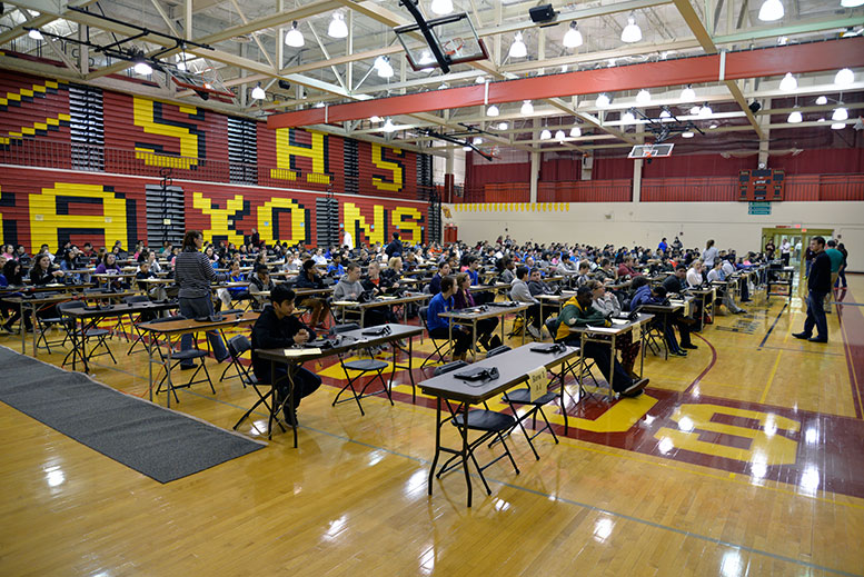 Schaumburg High School students enrolled in E101 English 1, E102 English 1, and E108 English 1 find their seats before the start of the Partnership for Assessment of Readiness for College and Careers (PARCC) Test on March 3.