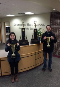 Melissa Tran, who took first in Debate for the Team trophy, and Nathanial Leonhardt, who took 2nd in Lincoln-Douglas (Debate), pose with the team's trophies after earning first place in state.