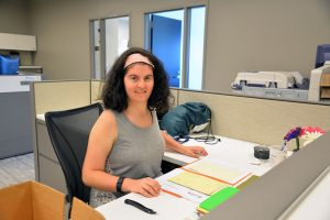 Allison works at her desk at the Palatine Police Department.