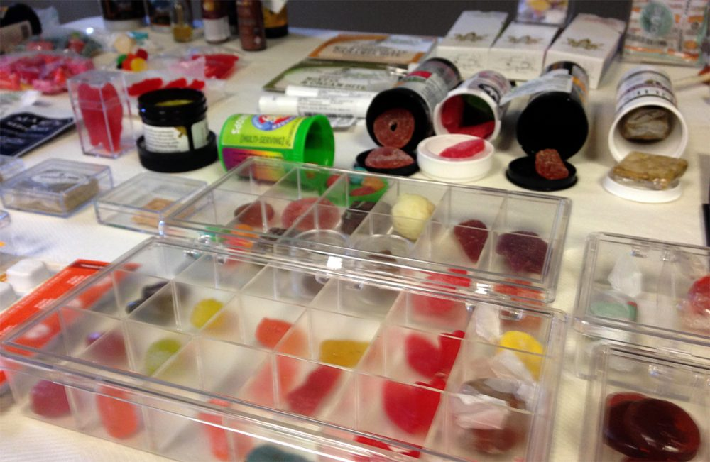 Candy infused with THC is displayed by opponents of legalized recreational marijuana on Thursday. (Steve Brown/WBUR)