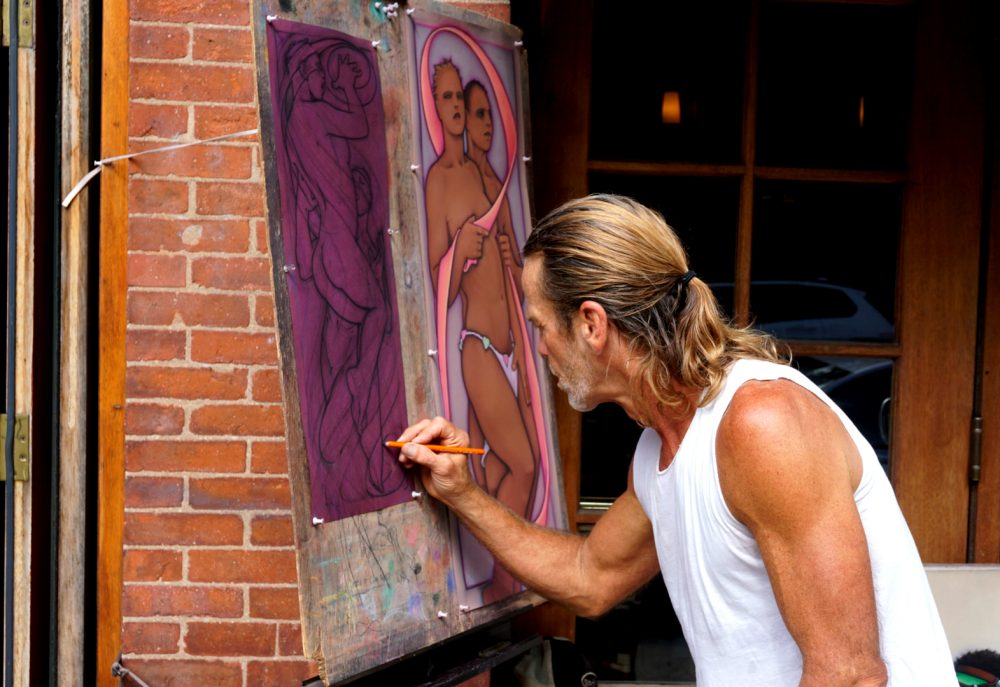Artist Eric Kluin outside the Newbury Street restaurant Sonsie. (Tom Meek for WBUR)