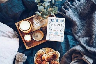 "A typical ""hygge"" scene, with warm pastries, soft lighting and a copy of Meik Wiking's ""Little Book Of Hygge."" (Valerie_bd/Instagram)"