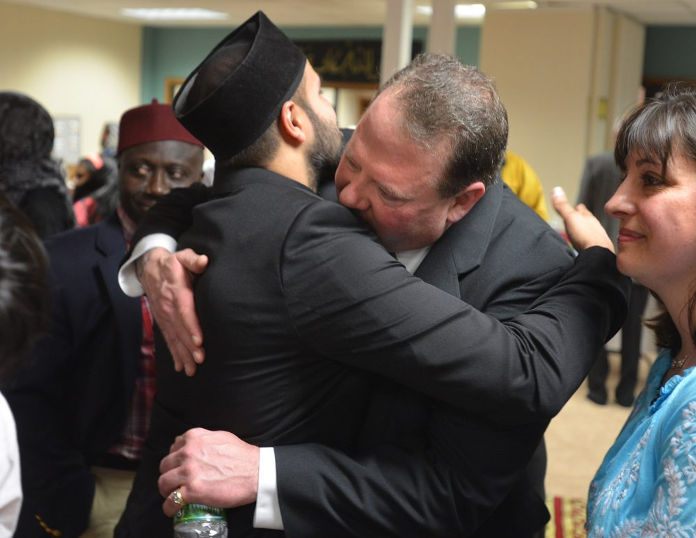 "Zahir Mannan hugs Ted Hakey at the Baitul Aman ""House of Peace"" Mosque after Ted's apology to the Ahmadiyya Muslim community. (Peter Casolino/Special to the Courant)"