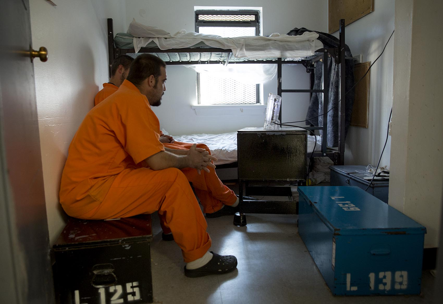 The men stay for 30 to 90 days in small rooms, which are former cells with metal mesh on the widows, bunk beds and wooden foot locker like benches. (Robin Lubbock/WBUR)