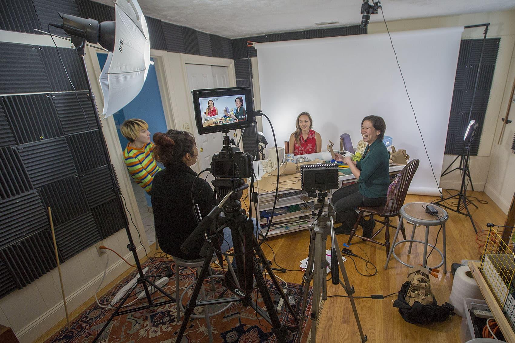 Art Prof co-founder Clara Lieu (far right) jokes with teaching assistants Annelise Yee, Deepti Menon and Lauryn Welch. (Jesse Costa/WBUR)