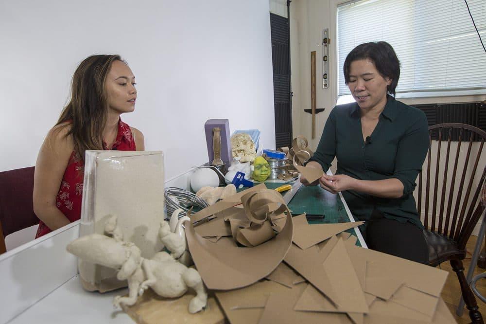 Teaching assistant Annelise Yee watches Art Prof co-founder Clara Lieu in her makeshift studio. (Jesse Costa/WBUR)
