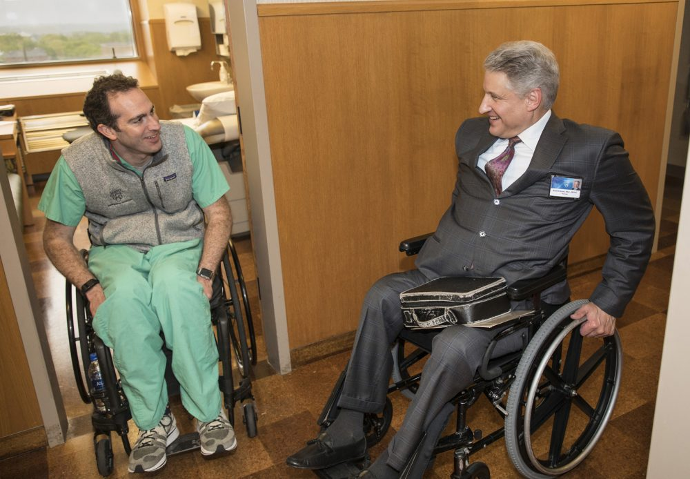 Dr. Daniel Grossman, left, a Mayo Clinic emergency room physician, credits neurologist Dr. Robert Brown with guiding him in recovery after being paralyzed as a result of a mountain bike accident last year. Brown, with a contagious positive attitude, helped Grossman return to work less than a year after his accident. (Jerry Olson for Here & Now)