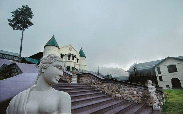 Striking statues and the atmospheric turrets of the Savoy on a misty day in Mussoorie