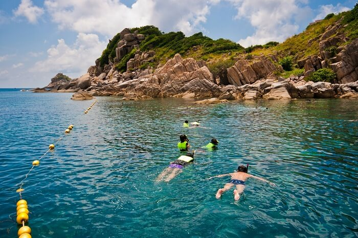 Tourists try snorkeling that is one of the best things to do in Koh Samui