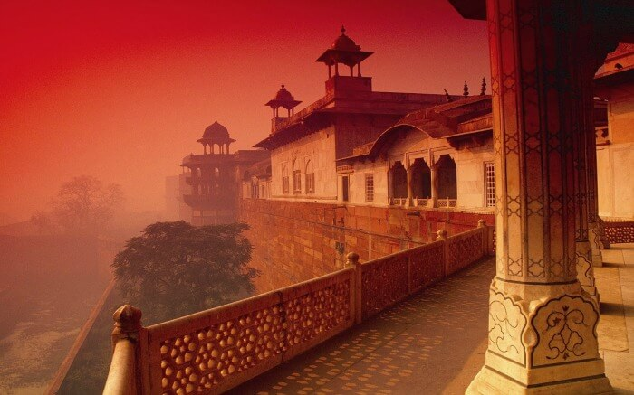 The rich red sandstone walls of the Agra Fort