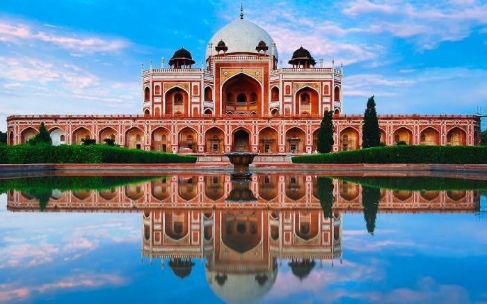 Humayun's Tomb on a cloudy evening with a mirror image in the front lake