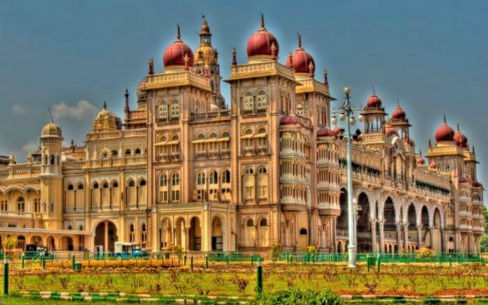 The courtyards and gardens surrounding the Mysore Palace