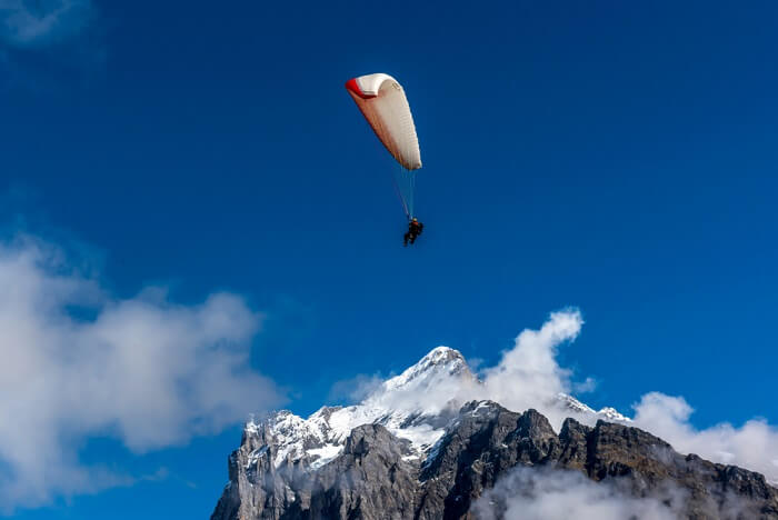 paragliding on snow m,ountains