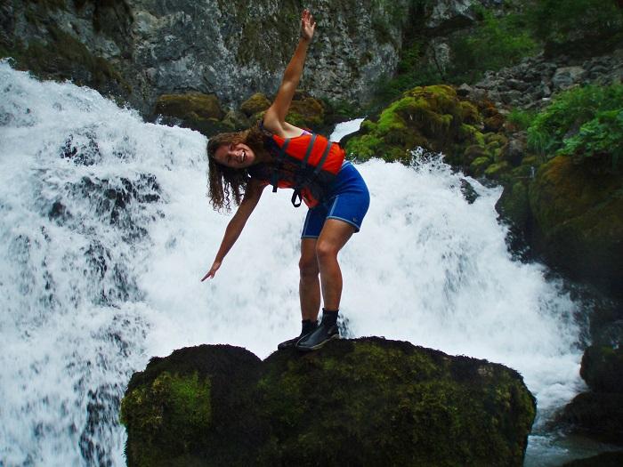Rock-hopping during rafting at the Tara river