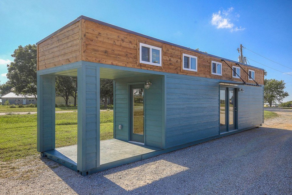 This Amazing Tiny Home With Porch Is Actually A 40 Foot