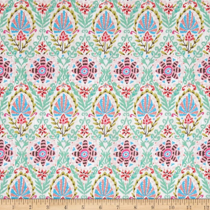 Designed by Dena Designs for Free Spirit Fabrics this cotton print is perfect for apparel quilting and home decor accents. Colors include shades of pink jade green turquoise dark chocolate and white.
