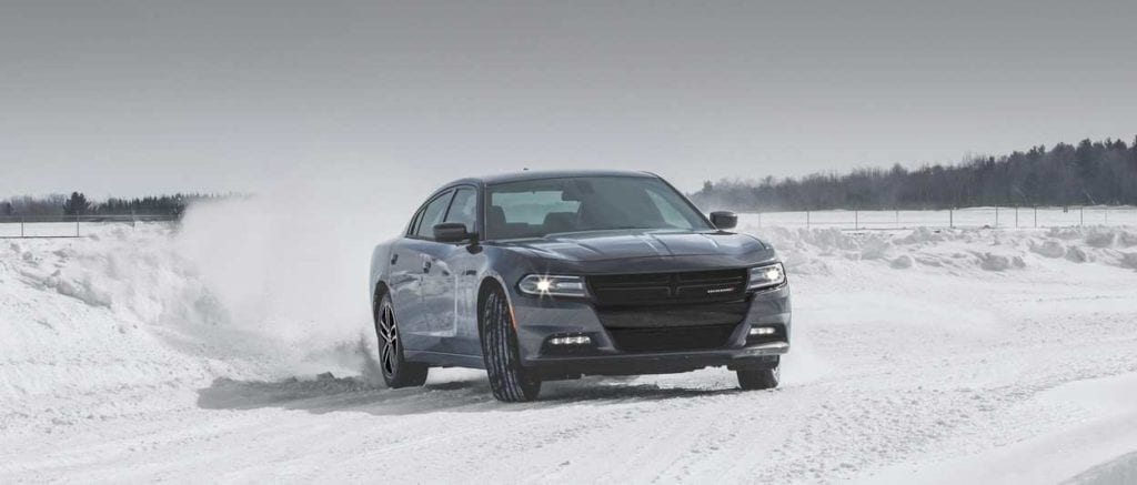2019 Dodge Charger parked in the snow with silver exterior