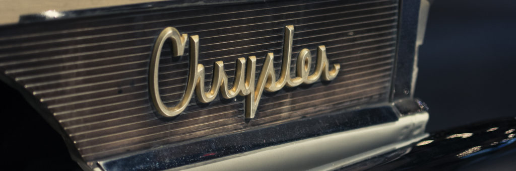 Chrysler vintage logo close up, on the side bumper of a Model 300 from the 60s.