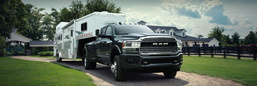 2020 Ram 3500 with a trailer on the back