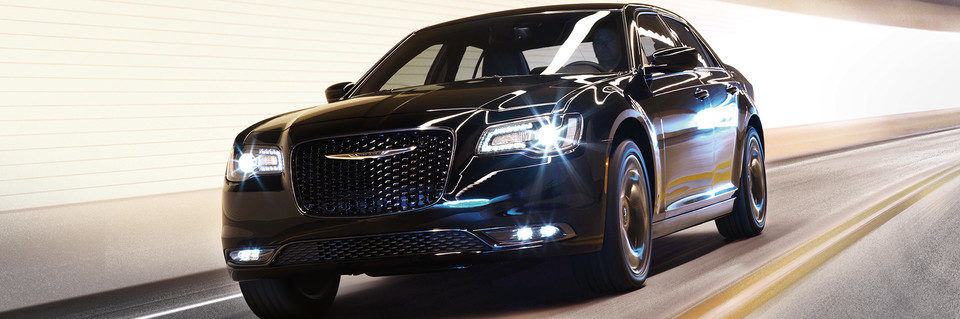 Front action shot of the 2020 Chrysler 300 shown in black featuring adaptive headlights