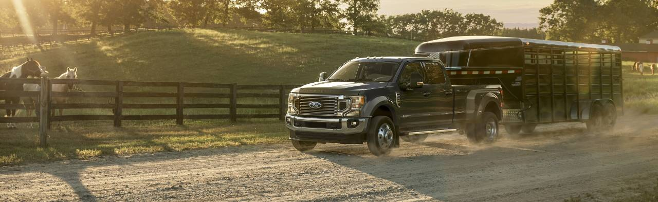 2021 Ford Super Duty F 4 50 towing a trailer down a country road