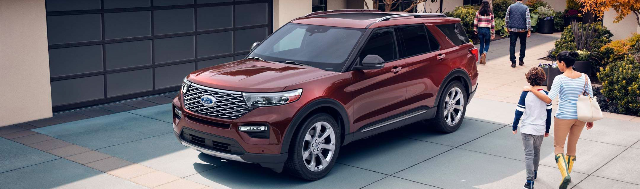 2020 Explorer shown parked outside a modern home