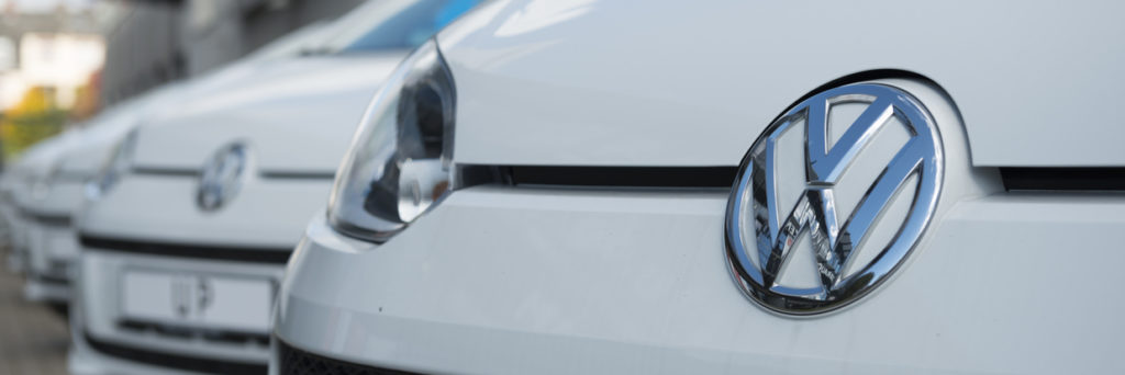 VW Logo on the Grille of a Volkswagen UP