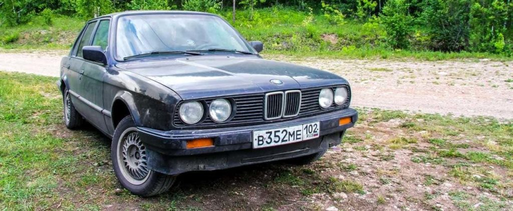 BIKSYANOVO, RUSSIA - JUNE 10, 2012: Motor car BMW E30 316i at the countryside.