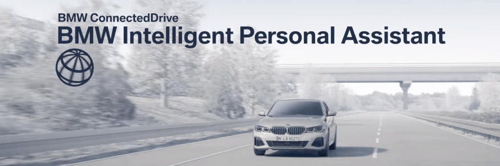 BMW Intelligent Personal Assistant in bold text, showcasing white BMW driving down whitewashed highway