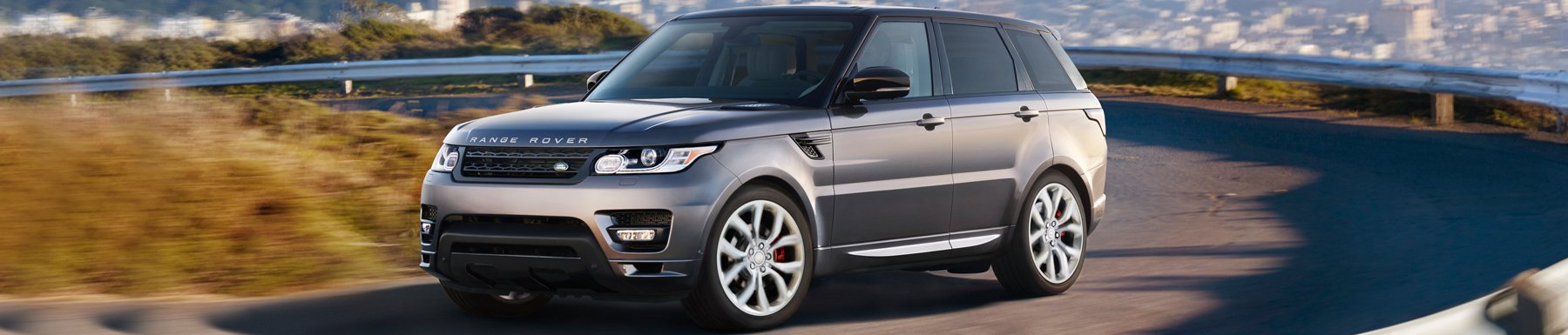 Land Rover - Range Rover driving down the road