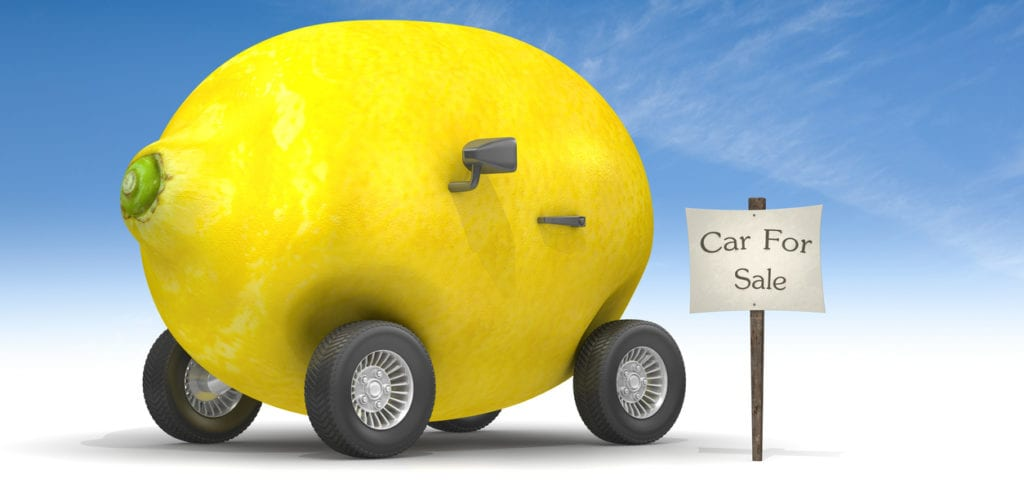 Lemon car for sale on a blue sky background.