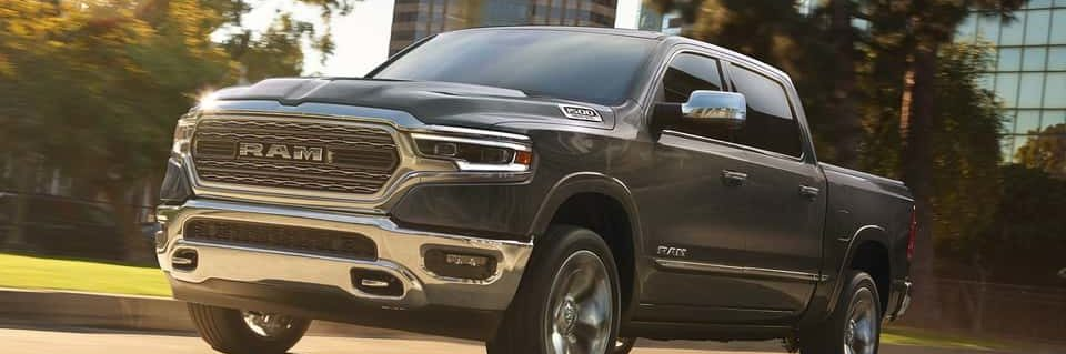 A black 2019 RAM 1500 driving down a city street