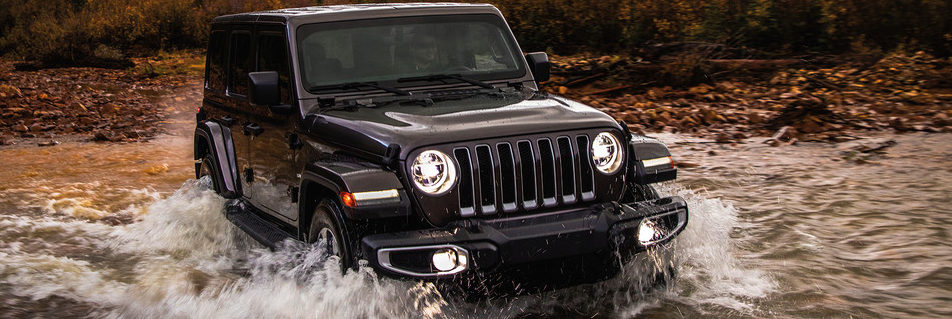 2019 Jeep Wrangler JL driving through a creek